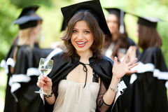 Bachelor graduates celebrate Royalty Free Stock Photography