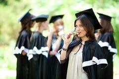 Bachelor graduates celebrate Royalty Free Stock Photos