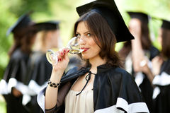 Bachelor graduates celebrate Stock Photo