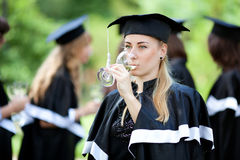 Bachelor graduates celebrate Stock Photography