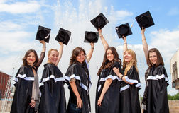 Bachelor graduates celebrate Stock Photos