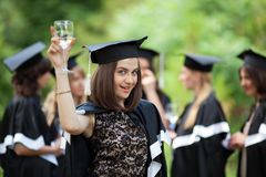 Bachelor graduates celebrate Royalty Free Stock Image