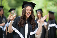 Bachelor graduates celebrate Royalty Free Stock Image