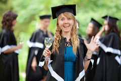 Bachelor graduates celebrate Royalty Free Stock Photo