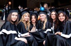 Bachelor graduates celebrate royalty free stock photography