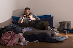 Bachelor and his mess. Bachelor is lazy and he doesn't clean up in apartament royalty free stock image