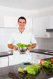 Bachelor in kitchen Stock Photos
