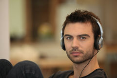 Bachelor listening to music Royalty Free Stock Image