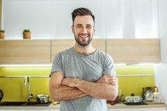 Bachelor man daily routine in the kitchen single lifestyle concept crossed arms stock photography