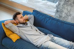 Bachelor man daily routine in the living room single lifestyle concept having nap Stock Photo