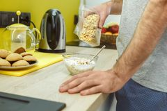 Bachelor man daily routine in the kitchen single lifestyle concept cooking breakfast close-up royalty free stock image