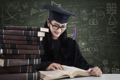 A bachelor is reading books at classroom Stock Image