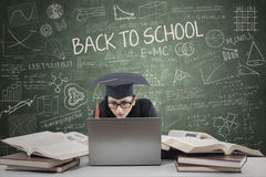 Bachelor studying in class 2 Stock Images