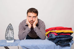Bachelor very bored by ironing Royalty Free Stock Photos