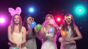 Bachelorette party girlfriends having fun with air balloons. Slow motion. Bachelorette party, girlfriends dancing and having fun with air balloons, on background stock video footage
