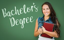 Bachelors Degree Written On Chalk Board Behind Mixed Race Young Royalty Free Stock Photos
