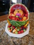 Bacia de fruto da festa do bebê imagem de stock