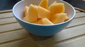 Bacia de fruto do melão do cantalupo imagem de stock