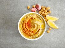 Bacia de hummus Imagem de Stock