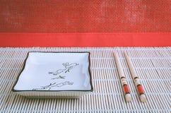Bacia e hashis quadrados Foto de Stock