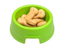 Bacia verde de biscoitos de cão osso-dados forma Imagens de Stock