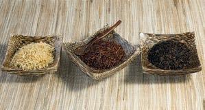 3 bacias de arroz cru Imagens de Stock