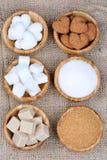 Bacias de bambu com tipos diferentes de açúcar Imagem de Stock Royalty Free