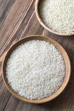 Bacias de camolino cru e do arroz basmati Foto de Stock Royalty Free