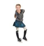 Bacio di salto sorridente dell'aria della bambina graziosa Fotografie Stock Libere da Diritti