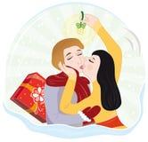 Bacio sotto il vischio Fotografia Stock