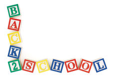 Back 2 School Frame. Wooden alphabet blocks at slight angles to each other arranged to form the words, 'back to school' in an 'L' shaped frame. Isolated on white Royalty Free Stock Image