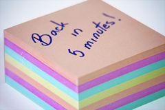 Back in 5 minutes. Shot of color note paper with massage,back in 5 minutes Royalty Free Stock Photography