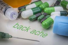 Back ache, medicines and syringes as concept. Of ordinary treatment health Stock Photo