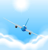 Back of airplane flying in the sky Stock Photo