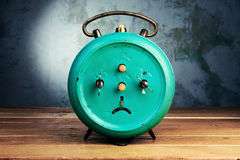 Back alarm clock on wooden table Stock Photo