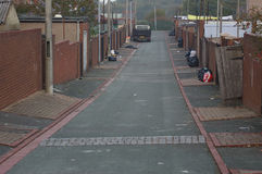 Back Alley 02. A Back Alley between two rows of terraced houses in Flintshire, Wales Stock Photos