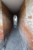 Back Alley. Narrow passageway between old buildings Stock Photos