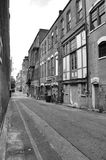 Back alley. A view of a back alley in a southern town. Shown in black and white Royalty Free Stock Photo