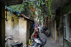 Back alley in Hanoi, Vietnam. Old town decaying architecture royalty free stock photos