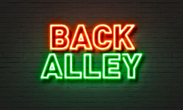 Back alley neon sign on brick wall background. Royalty Free Stock Photography