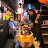 Back alley restaurant scene in Shinjuku, Tokyo. Ovoid Yokocho also known under its more colorful nickname Piss Alley, is a small network of alleyways along the Stock Images