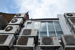 Back alley of shophouse with multiple air-con unit Stock Photo