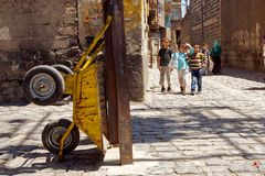 Back alleys of Diyarbakir, Turkey. Back alleys of Diyarbakir old town. Poverty of this district does not scare children playing on tangled cobble stone streets Royalty Free Stock Photo