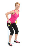 Back and arms exercise using rubber resistance band Royalty Free Stock Photos