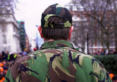 Back of army soldier. Portrait of the back of an army soldier wearing jungle camouflage fatigues Royalty Free Stock Images