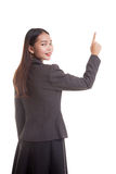 Back of Asian business woman touching the screen with her finger Stock Images