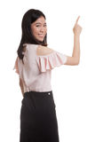 Back of Asian business woman touching the screen with her finger Stock Photography