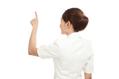 Back of Asian business woman touching the screen with her finger Royalty Free Stock Images