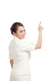 Back of Asian business woman touching the screen with her finger Royalty Free Stock Image