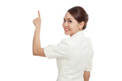 Back of Asian business woman touching the screen with her finger Royalty Free Stock Photo